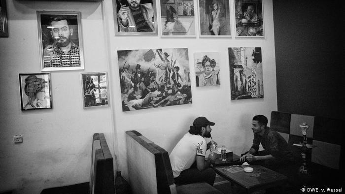 Two men talking in a cafe
