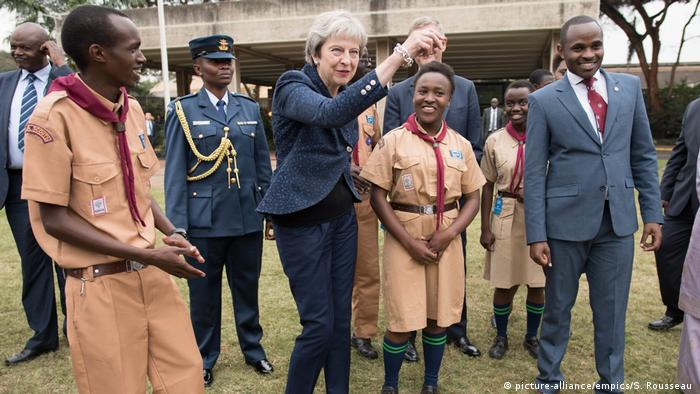 Prime Minister Theresa May in breaks into dance whilst meeting with scouts at the United Nations offices in Nairobi