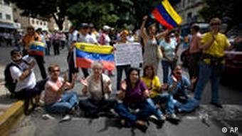 Demonstrators protest against the closure of Venezuelan CNB radio station in Caracas,