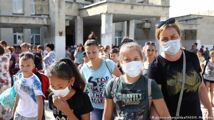 Children wear face masks in Crimea