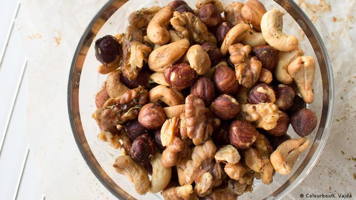 """Image result for kenyan eating nuts"""""""