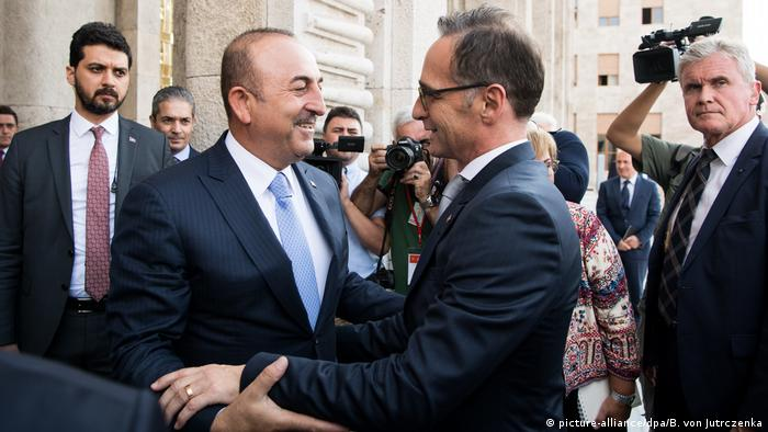 Maas embraces his counterpart Cavusoglu