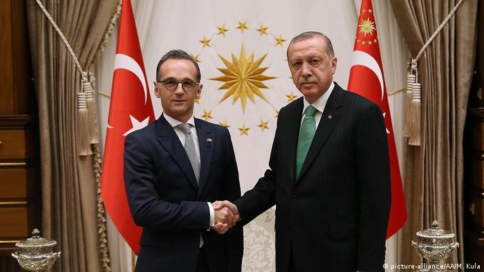 German Foreign Minister Heiko Maas with Erdogan in front of two Turkish flags, inside the presidential complex in Ankar