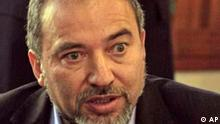 Leader of Israel's right-wing Yisrael Beiteinu Party Avigdor Lieberman speaks to journalists during a visit to Kibbutz Nirim, just outside the Gaza Strip, Wednesday, Feb. 4, 2009. The hottest slogan in this Israeli election campaign has supporters cheering and critics cringing: Without loyalty, there is no citizenship. The ominous motto is plastered nationwide across buses and billboards. Above it looms the dour, bearded face of its mastermind, Avigdor Lieberman, Israel's most divisive politician and the man who could soon become the kingmaker of Israeli politics.(AP Photo/Tsafrir Abayov)