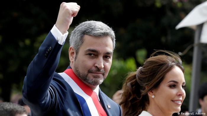 Paraguay's new President Mario Abdo Benitez gestures to the public as he rides in an open car alongside Paraguay's first lady Silvana Lopez Moreira after his inauguration ceremony in Asuncion, Paraguay August 15, 2018