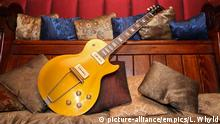 Rock legends' guitars and cars go on sale.A 1952 Gibson Les Paul, previously owned by Eric Clapton, Peter Green and Duster Bennett. Picture date: Friday March 6, 2009. Guitars and cars previously owned by rock legends will be auctioned by Coys on March 12th. More than 45 vintage guitars owned by rock guitarists, and cars owned by Rod Stewart, Dusty Springfield and an Aston Martin DB5 featured in the famous Robbie Williams video for Millennium will all go under the hammer. See PA story SALE Rock. Photo credit should read: Lewis Whyld/PA Wire URN:6963949 |