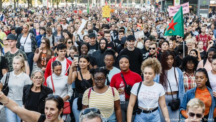 People take part in a protest against a far-right demonstration in Hamburg