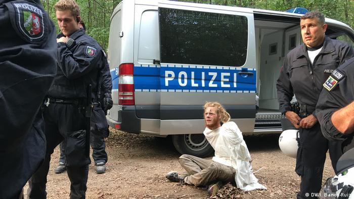 Hambach forest protester sitting in front of a police car