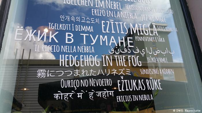 The window of a café displays the title of a popular Soviet cartoon in numerous languages in Daugavpils, Latvia