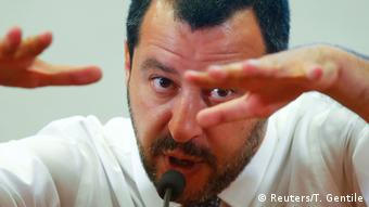 Salvini makes a gesture with his hands