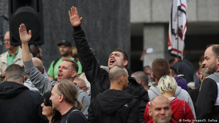A man raises his arm in a Heil Hitler salute