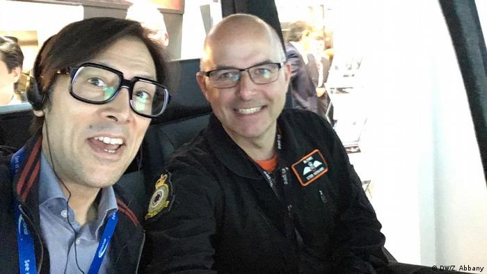 DW Science's Zulfikar Abbany (left) with Inzpire's Alistair Howard (right) inside a helicopter flight simulator at the 2018 Farnborough Airshow