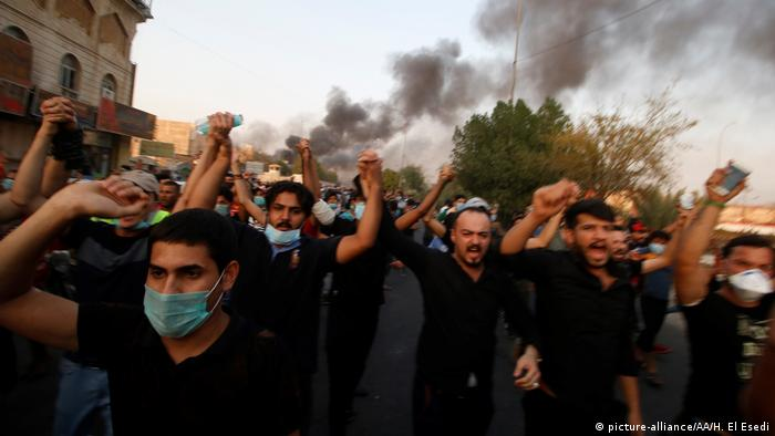 Protestors shout slogans during the funeral of a demonstrator killed in Basra
