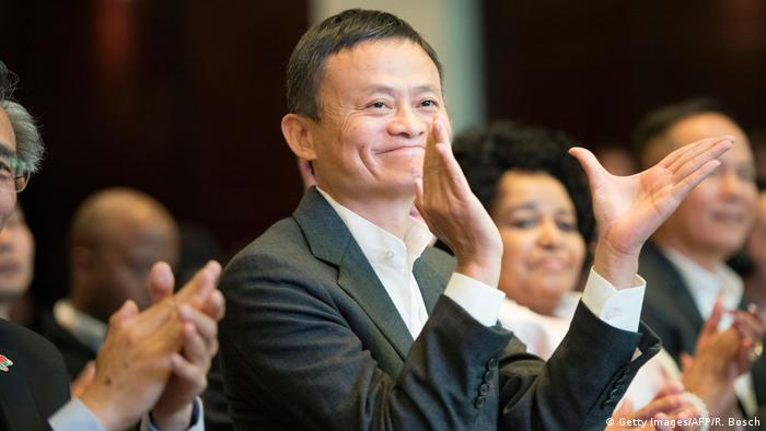 Alibaba chief executive Jack Ma clapping his hands