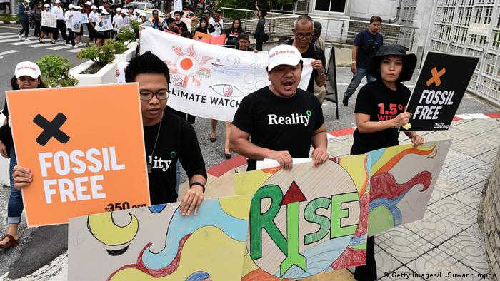 Environmental activists and supporters take part in a demonstration in front of the United Nations building in Bangkok, Thailand