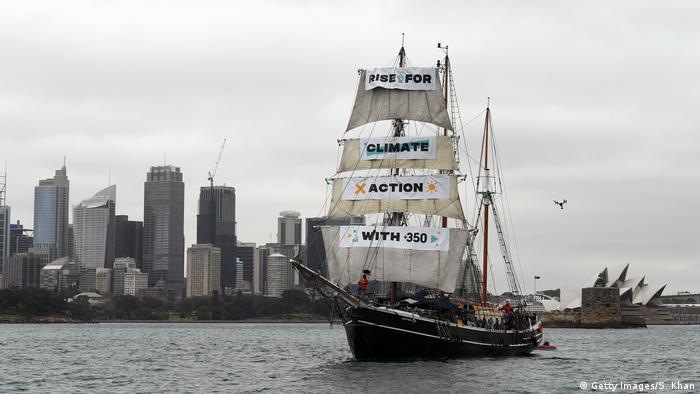 The tall ship Southern Swan sails in Sydney Harbour in front of the Opera House with environmentalists on board on September 8