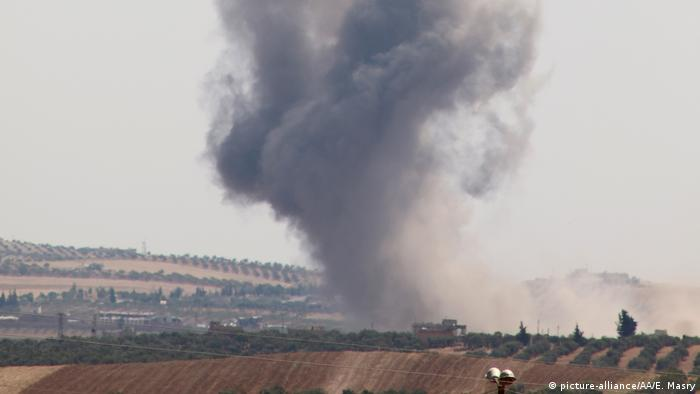 Smoke rises after war planes belonging to the Assad regime and Russia carried out airstrikes in Idlib province