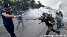 Protesters clash with police during a demonstration against the agreement reached by Greece and Macedonia to resolve a dispute over the former Yugoslav republic's name, during the opening of the annual International Trade Fair of Thessaloniki by Greek Prime Minister Alexis Tsipras in Thessaloniki, Greece, September 8, 2018. REUTERS/Alexandros Avramidis