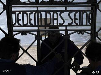 Workers mount a duplicate of the entrance gate with the slogan 'To Each His Own' in the former Nazi concentration camp Buchenwald near Weimar
