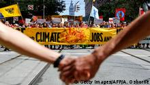 The Ferry Building is seen as crowds march up Market Street during the Rise For Climate global action on September 8, 2018 in downtown San Francisco, California. - Rise For Climate is a global day of action demanding real climate solutions from local leaders. (Photo by Amy Osborne / AFP) (Photo credit should read AMY OSBORNE/AFP/Getty Images)