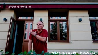 Uwe Diuballa standing outside his restaurant