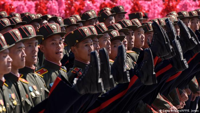 Korean People's Army soldiers march during a mass rally on Kim Il Sung square