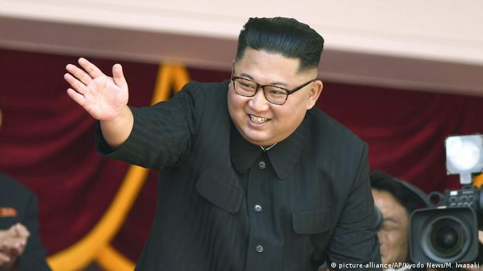 North Korean leader Kim Jong Un waves during a parade for the 70th anniversary of North Korea's founding day in Pyongyang, North Korea