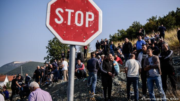 Kosovo Albanians gather around a barricade as they block on September 9, 2018 access to a village due to be visited by Serbian President