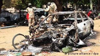 A bombed out car in Abuja, Nigeria