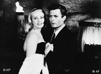 FItalian actress Anita Ekberg, left, appears as Sylvia Rank and co-star Marcello Mastroianni as the journalist Marcello Rubini in Fellini's 1960 film La Dolce Vita. (AP Photo)