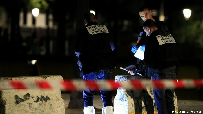 French police stand at the scene of a stabbing attack in Paris (Reuters/G. Fuentes)
