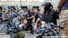 09.09.2018+++ A serviceman of the Russian National Guard beats a protester during a rally against planned increases to the nationwide pension age in Moscow, Russia September 9, 2018. REUTERS/Sergei Karpukhin