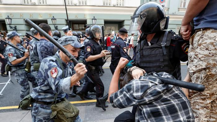 Russian police restrain a protester during a demonstration against proposed changes to the pension age in Moscow (Reuters/S. Karpukhin)