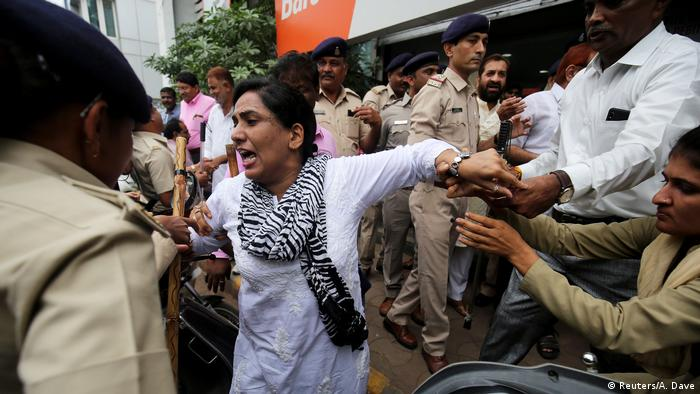 Authorities restrain a woman as she protests against fuel price hikes in Ahmedabad, India (Reuters/A. Dave)