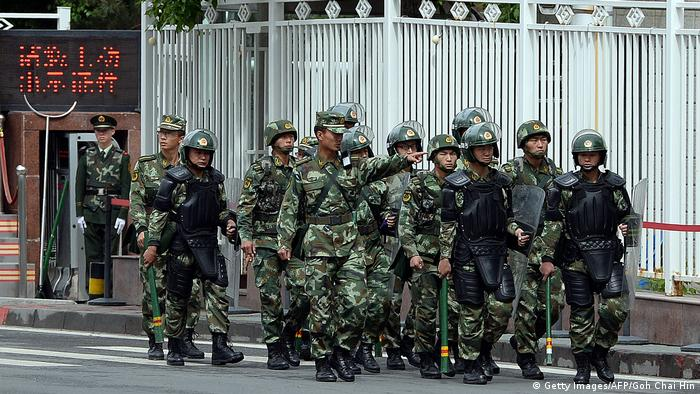 Chinese paramilitary police patrol Urumqi following a bombing in 2014