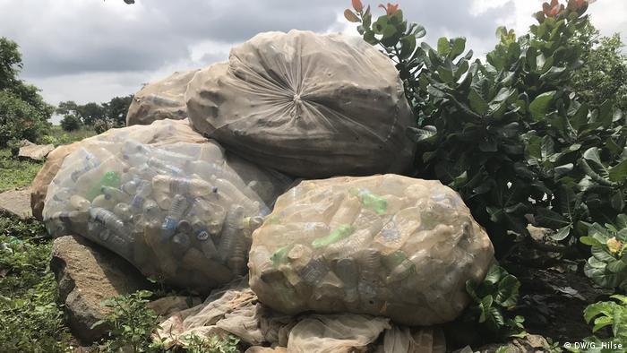 Bags of plastic bottles piled high