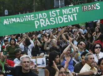 Hundreds of people take to the streets of Berlin on August 4 to protest against the re-election of Ahmadinedschad
