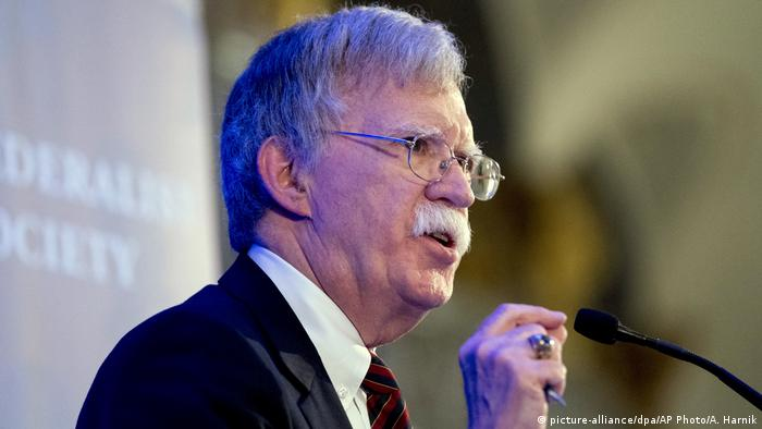 US national security adviser John Bolton speaking into a microphone
