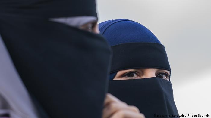 Two women wearing the face veil niqab