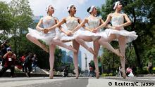 The classical ballet company Ardentia performs in the street of Mexico City on traffic lights, in an effort to highlight the city's fine arts in public spaces in Mexico, September 8, 2018. REUTERS/Carlos Jasso