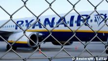 FILE PHOTO: An aircraft of low-cost airliner Ryanair is seen behind a fence while being parked at the tarmac of Weeze airport near the German-Dutch border during a wider European strike of Ryanair airline crews to protest slow progress in negotiating a collective labour agreement at Weeze airport, Germany August 10, 2018. REUTERS/Wolfgang Rattay/File Photo