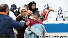 ©Kyodo/MAXPPP - 04/08/2018 ; Photo taken in April 2018 shows Syrian refugees landing on the Greek island of Lesbos after being rescued by a coast guard vessel. (Kyodo) ==Kyodo Foto: MAXPPP |