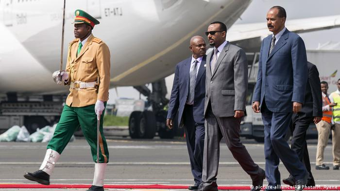 Eritrea's President Isaias Afwerki, right, is welcomed by Ethiopia's Prime Minister Abiy Ahmed, 2nd right - file photo