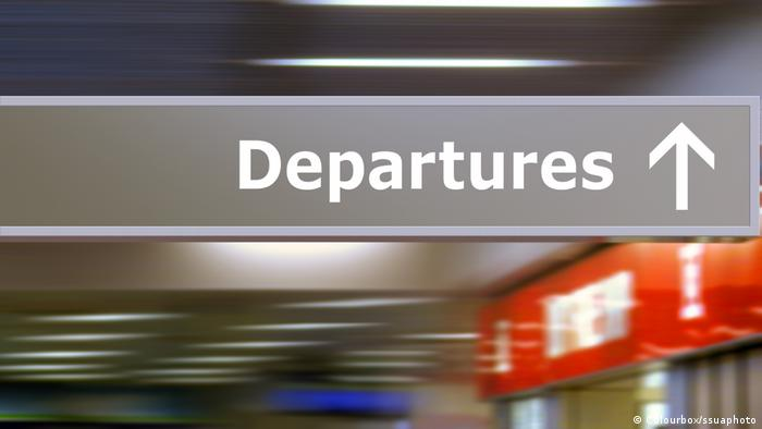 A departure sign at the airport