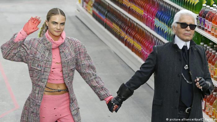 German designer Karl Lagerfeld (R) and British model Cara Delevingne (L) take to the catwalk