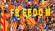 People hold up Catalan separatist flags and letters spelling out Freedom as they gather for a rally on Catalonia's national day 'La Diada' in Barcelona, Spain, September 11, 2018. REUTERS/Albert Gea