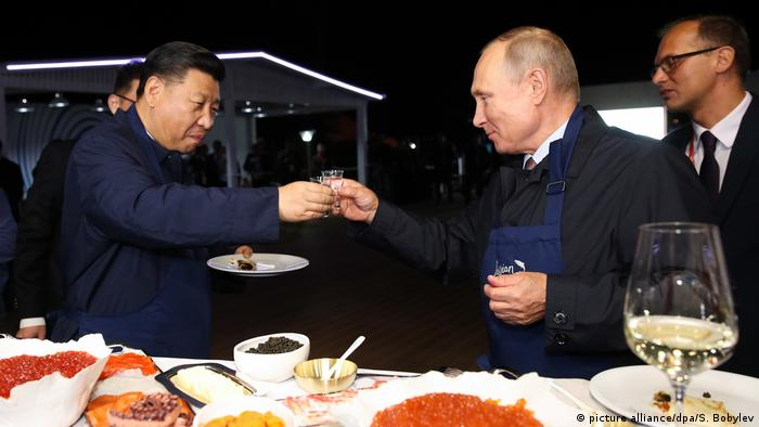 In a show of good relations between the two allies, Xi was treated to pancakes with caviar and shots of vodka by his host.