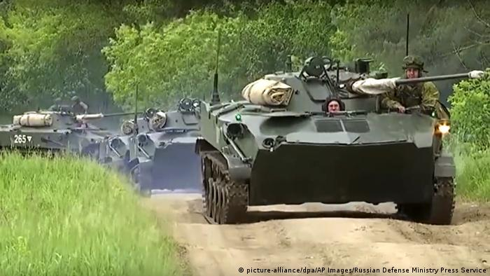 Russian armored personnel carriers roll during the military exercises in the Chita region
