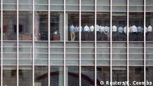 Bankers attend an emergency meeting at the London office of Lehman Brothers, in the financial district of Canary Wharf in London, Britain, September 11, 2008. The photograph caught the moment when Gwion Moore, one of those pictured in the photograph, and his colleagues were being told by bosses that things were going to be OK, despite the plummeting Lehman Brothers share price. Senior management thought they needed to get the workforce focused again, Moore said. The phrase was stop 'goofing around and get back to work'. I don't think anyone took the message very seriously because we went back to doing what we had been doing beforehand. No one was going to trade with us. REUTERS/Kevin Coombs/File photo SEARCH LEHMAN 10 FOR THIS STORY. SEARCH WIDER IMAGE FOR ALL STORIES. TPX IMAGES OF THE DAY.