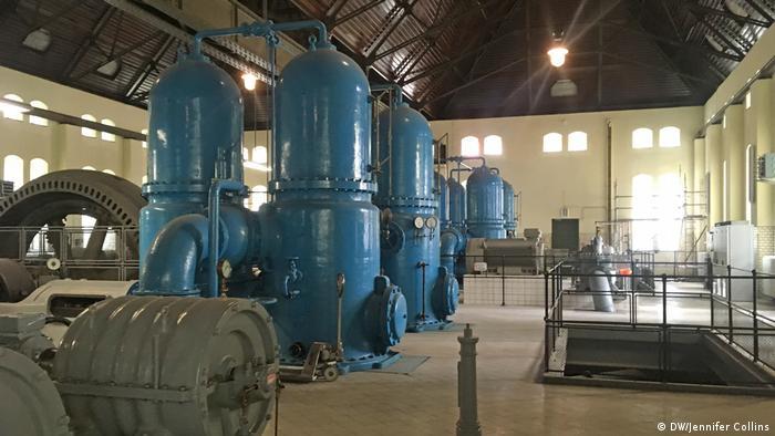 Large old blue metal pumps in a huge room